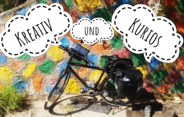 Kreativ und Kurios - Bild mit buntem Fahrrad